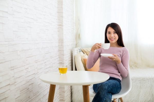 Woman enjoy tea at home