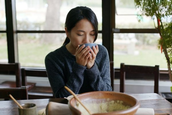 Woman enjoy the Hakka Lei Cha at tea house